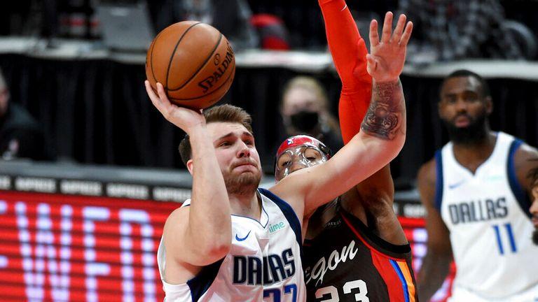 AP - Dallas Mavericks guard Luka Doncic (77) drives to the basket on Portland Trail Blazers forward Robert Covington (23)