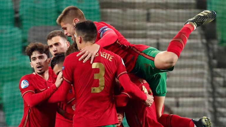 Portugal's Dany Mota celebrates with teammates after scoring against England U21