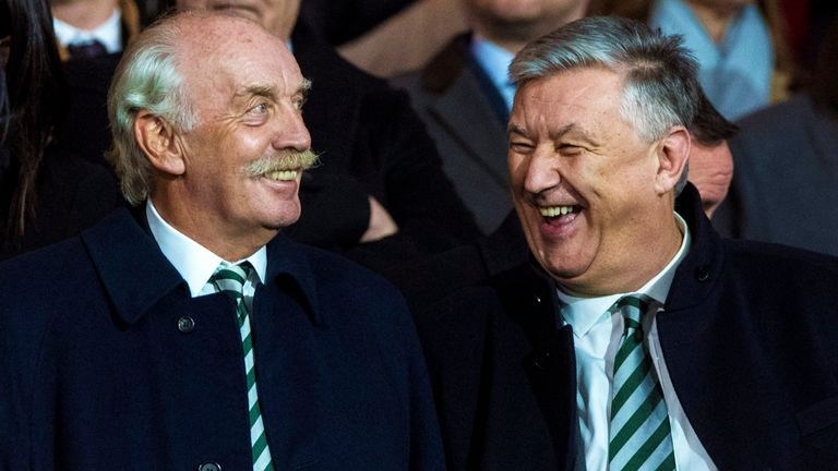 Celtic majority shareholder Dermot Desmond (left) speaks to outgoing chief executive Peter Lawwell (right)