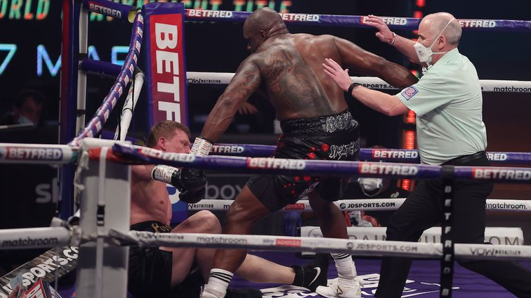 *** FREE FOR EDITORIAL USE ***.Alexander Povetkin v Dillian Whyte,  Interim WBC Heavyweight World Title..27 March 2021.Picture By Mark Robinson Matchroom Boxing.Dillian Whyte knocks down Alexander Povetkin.