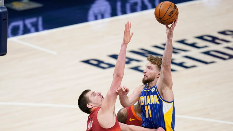 Indiana Pacers' Domantas Sabonis shoots over Denver Nuggets' Nikola Jokic during the first half of an NBA basketball game