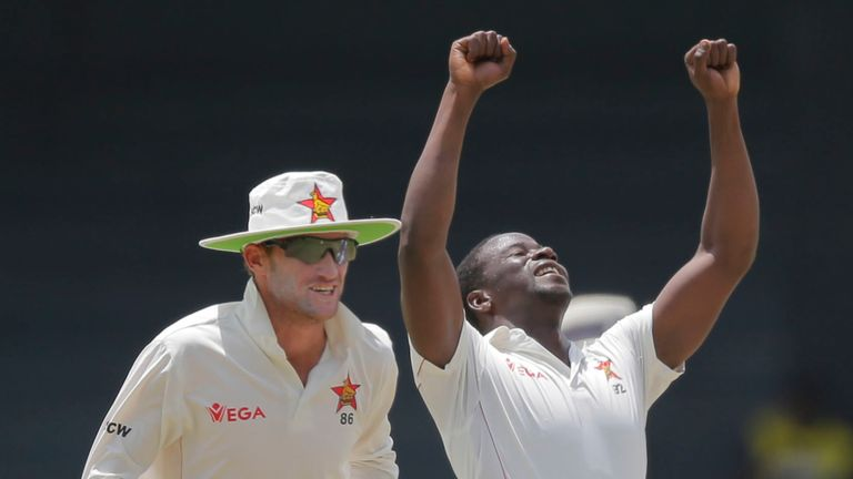 Zimbabwe's Donald Tiripano (R) took the final three wickets to wrap up Afghanistan's second innings for 135
