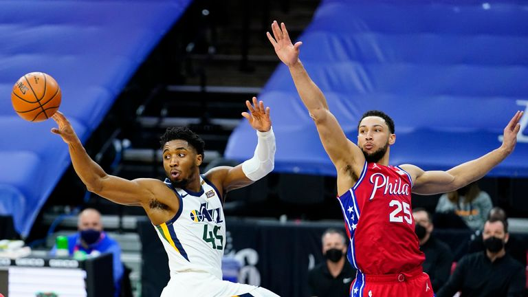 Utah Jazz's Donovan Mitchell passes the ball against Philadelphia 76ers' Ben Simmons