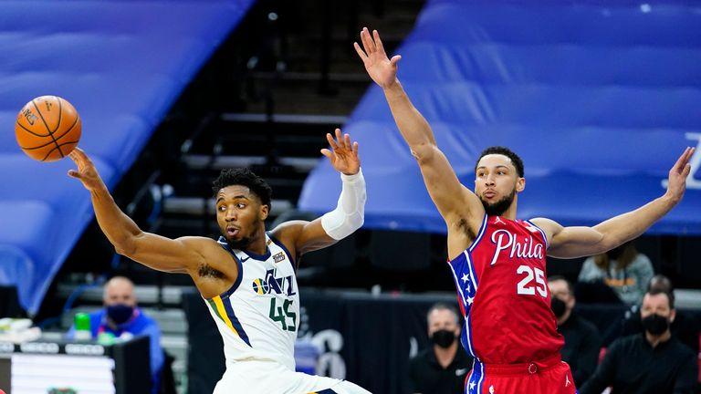 Utah Jazz's Donovan Mitchell passes the ball against Philadelphia 76ers' Ben Simmons