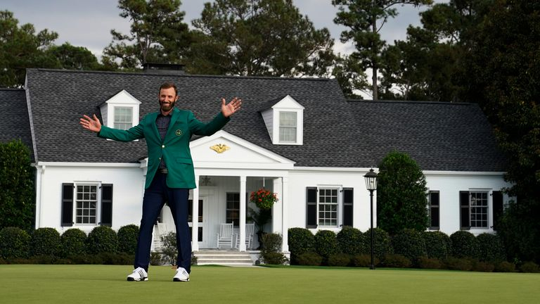 Dustin Johnson proudly displays his Green Jacket after winning the 2020 Masters