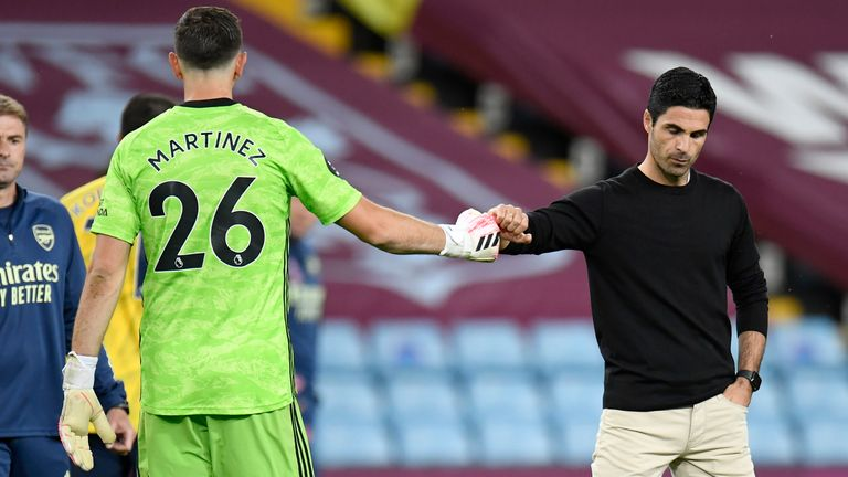 Arsenal...s head coach Mikel Arteta gestures with his goalkeeper Emiliano Martinez after the English Premier League soccer match between Aston Villa and Arsenal at Villa Park in Birmingham, England, Tuesday, July 21, 2020. (AP Photo/Peter Powell,Pool).