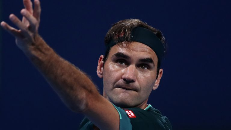 Roger Federer beat Dan Evans in three sets to seal a winning return to the court