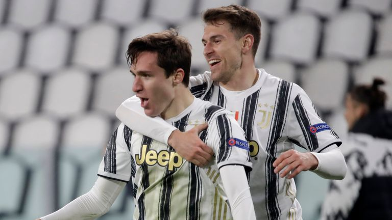 Juventus' Federico Chiesa celebrates with Aaron Ramsey after scoring against Porto