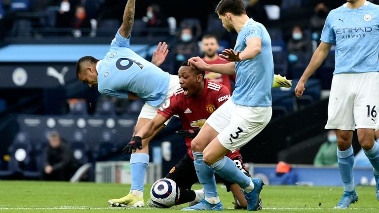 Gabriel Jesus fouls Anthony Martial that results in a penalty to Manchester United