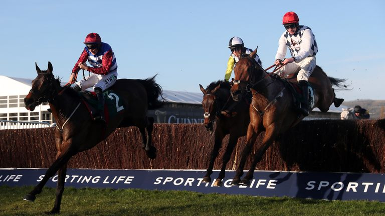 Galvin (right) on his way to victory under Jack Kennedy in the National Hunt Chase