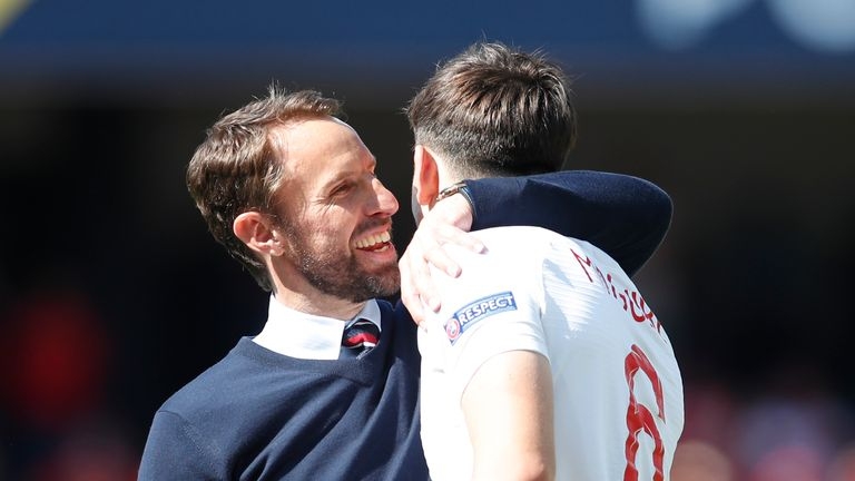 AP - Harry Maguire with Gareth Southgate