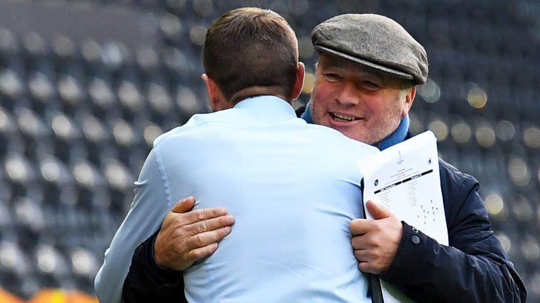 Ally McCoist and Steven Gerrard embrace during a match in the Europa League