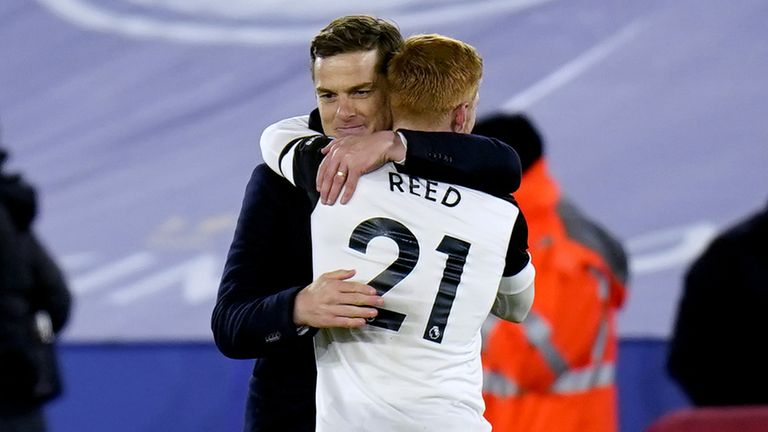 Scott Parker hugs Harrison Reed as they celebrate Fulham's win over Sheffield United