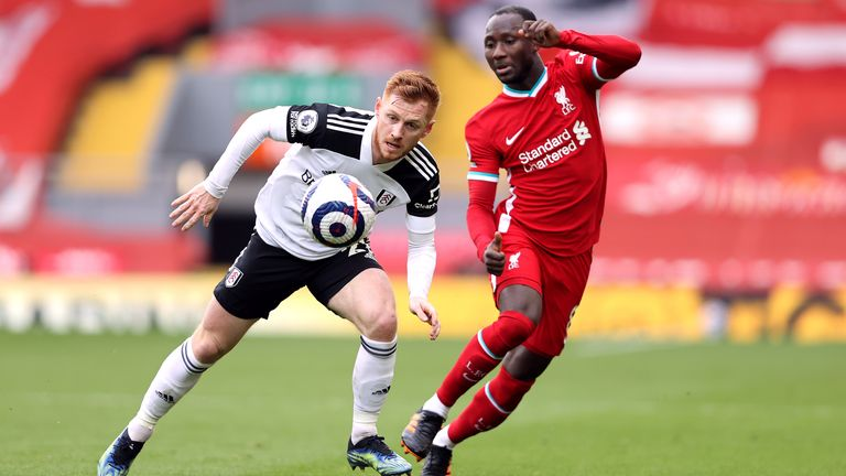 Harrison Reed and Naby Keita battle for possession at Anfield