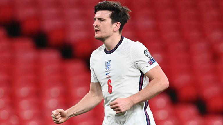 Harry Maguire celebrates his winner against Poland