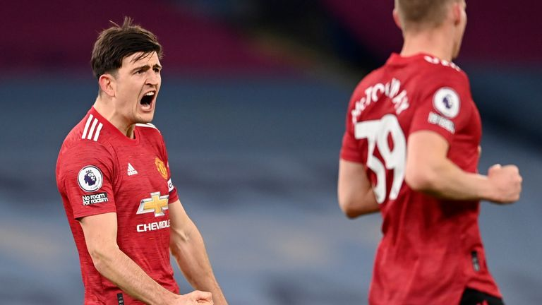 Harry Maguire roars with delight at the final whistle at the Etihad