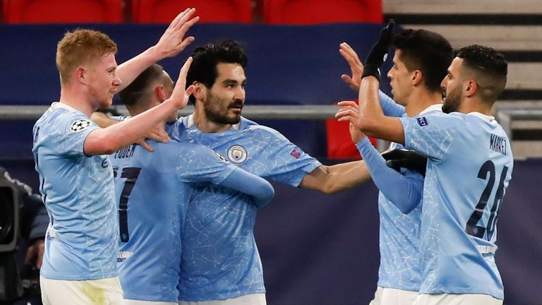 Ilkay Gundogan, centre, is congratulated by Man City team-mates after scoring
