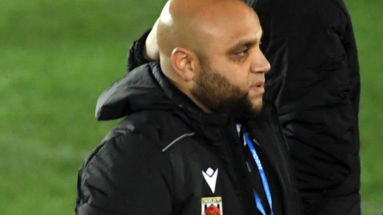 Chorley head of coaching and youth development Irfan Kawri  celebrates after FA Cup second round match at the Weston Homes Stadium, Peterborough.
