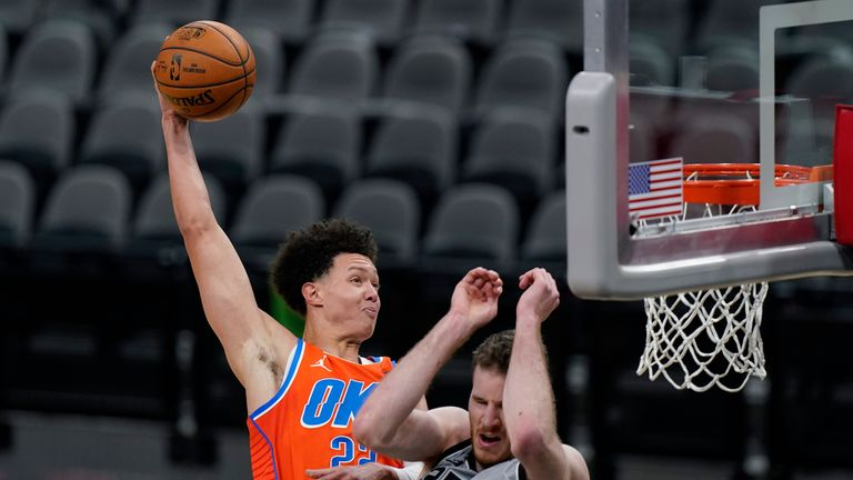 Oklahoma City Thunder center Isaiah Roby scores over San Antonio Spurs center Jakob Poeltl