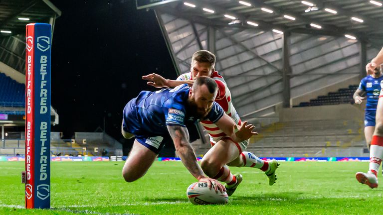 Jake Bibby goes over for a try as Wigan fought back to beat Leigh