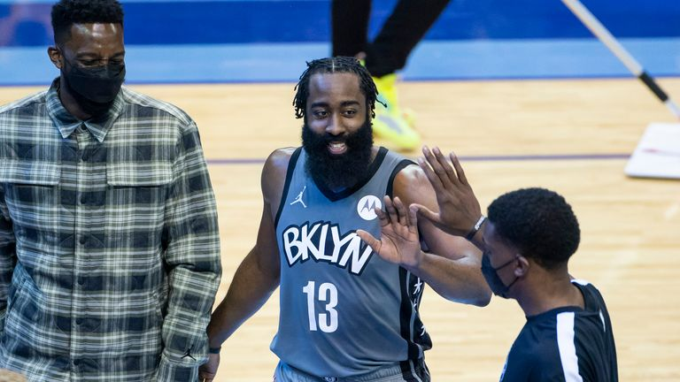 Brooklyn Nets guard James Harden celebrates as he leaves the game during the second half of an NBA basketball game against the Houston Rockets