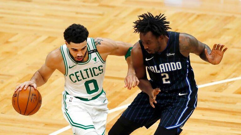 AP - Boston Celtics' Jayson Tatum (0) drives past Orlando Magic's Al-Farouq Aminu (2)