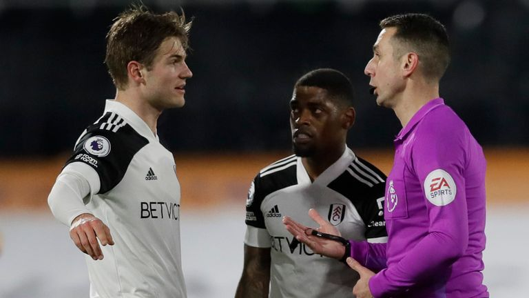 Fulham captain Joachim Andersen talks to referee David Coote after their equaliser was disallowed for handball