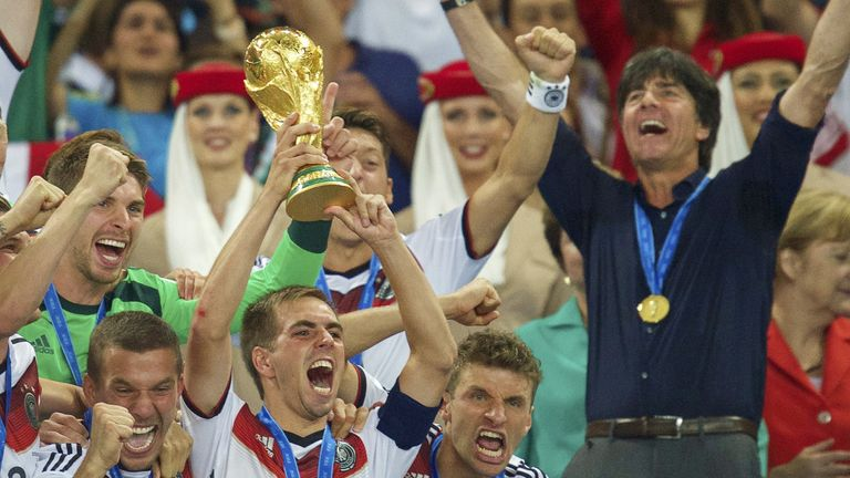 (L-R) Lukas Podolski of Germany, Philipp Lahm of Germany, Thomas Muller of Germany, coach Joachim Low of Germany with world cup trophy during the final of the FIFA World Cup 2014 on July 13, 2014 at the Maracana stadium in Rio de Janeiro, Brazil.(
