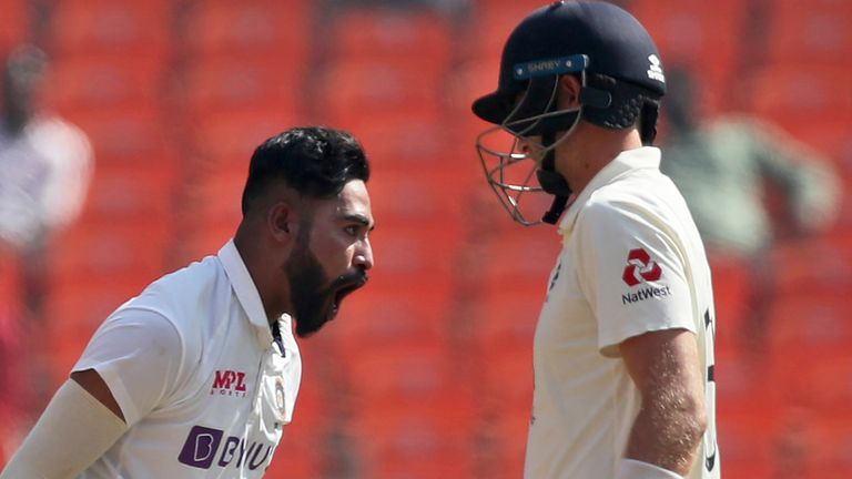 AP Sport - India's Mohammed Siraj, left, celebrates the dismissal of England's captain Joe Root, right, during the first day of fourth cricket test match between India and England at Narendra Modi Stadium in Ahmedabad, India, Thursday, March 4, 2021. (AP Photo/Aijaz Rahi)