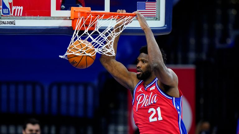 Philadelphia 76ers' Joel Embiid dunks the ball during the second half of an NBA basketball game against the Utah Jazz