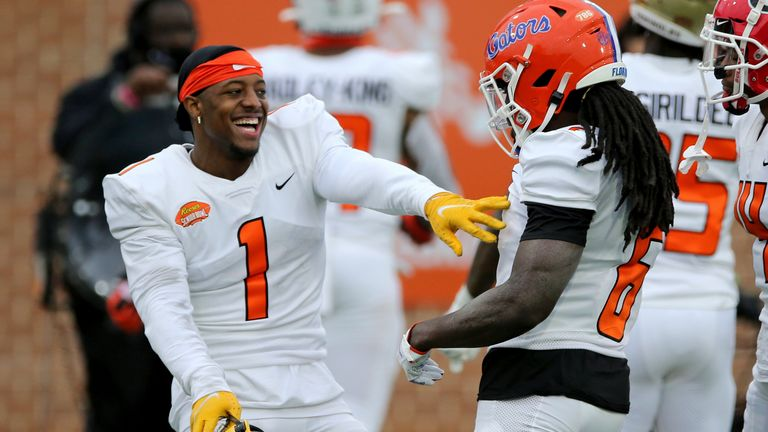 Bledsoe (1) celebrates a play with Florida defensive back Shawn Davis during the Senior Bowl. (AP Photo/Rusty Costanza)