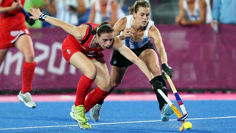 Great Britain's Kate Richardson-Walsh is tackled by Argentina's Carla Rebecchi. Picture date: Wednesday August 8, 2012. See PA story OLYMPICS .