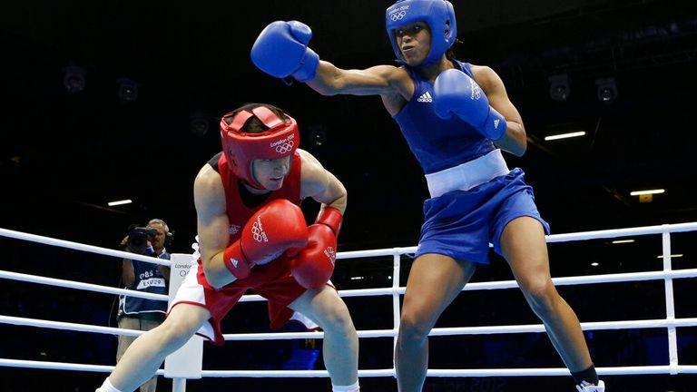 Ireland's Katie Taylor, left, ducks a punch from Britain's Natasha Jonas in a women's lightweight 60-kg quarterfinal boxing match at the 2012 Summer Olympics, Monday, Aug. 6, 2012, in London. (AP Photo/Patrick Semansky)