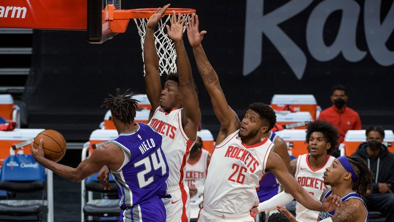 Sacramento Kings keeper Buddy Hield drives to the basket as the Houston Rockets attack Jae Sean Tate and Rockets center Justin Patton defend