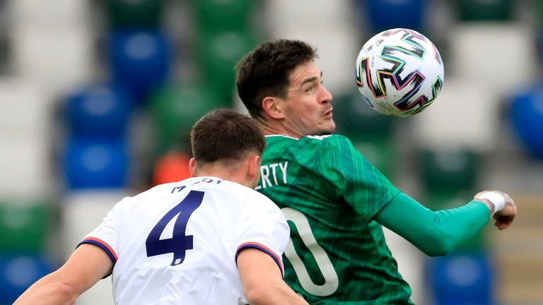 Northern Ireland's Kyle Lafferty jumps for the ball with Matthew Miazga