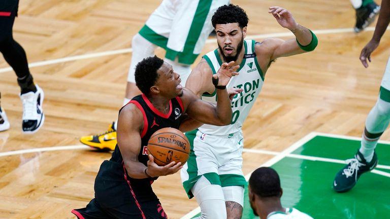 Toronto Raptors guard Kyle Lowry drives to the basket against Boston Celtics forward Jayson Tatum
