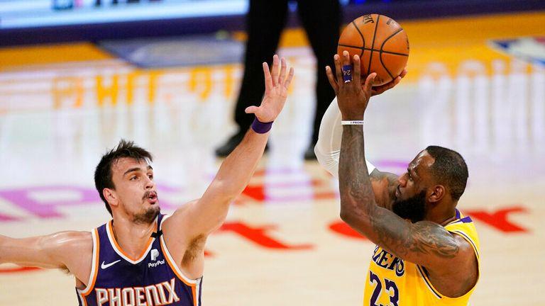 AP - Los Angeles Lakers forward LeBron James, right, shoots as Phoenix Suns forward Dario Saric defends