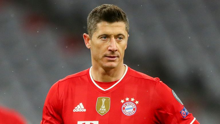 Bayern's Robert Lewandowski holds a ball before scoring from a penalty kick during the Champions League, round of 16, second leg soccer match between FC Bayern Munich and Lazio at the soccer Arena stadium in Munich, Germany, Wednesday, March 17, 2021. (AP Photo/Matthias Schrader)
