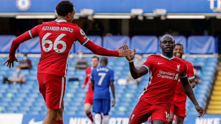 Liverpool's Sadio Mane is congratulated by Liverpool's Trent Alexander-Arnold after scoring during the English Premier League soccer match between Chelsea and Liverpool at Stamford Bridge Stadium, Sunday, Sept. 20, 2020. (AP Photo/Matt Dunham, Pool)