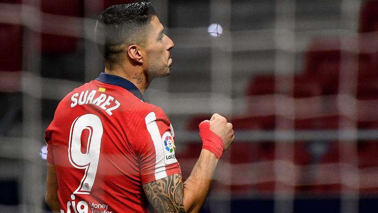 Luis Suarez celebrates during Atletico Madrid's win