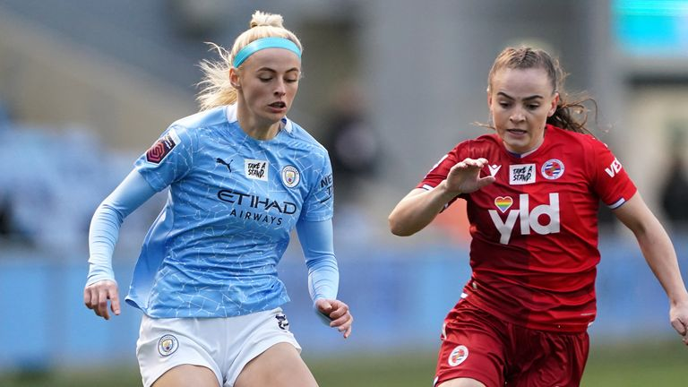 Manchester City's Chloe Kelly (left) and Reading's Lily Woodham battle for the ball