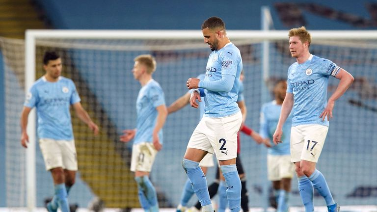 Manchester City's Kyle Walker and Kevin De Bruyne (right) appears dejected after the final whistle during the Premier League match at the Etihad Stadium, Manchester. Picture date: Sunday March 7, 2021.