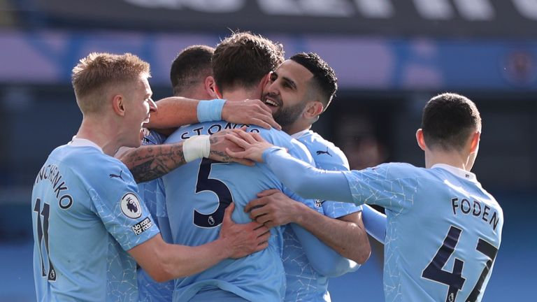 Manchester City players celebrate John Stones' winning goal against West Ham