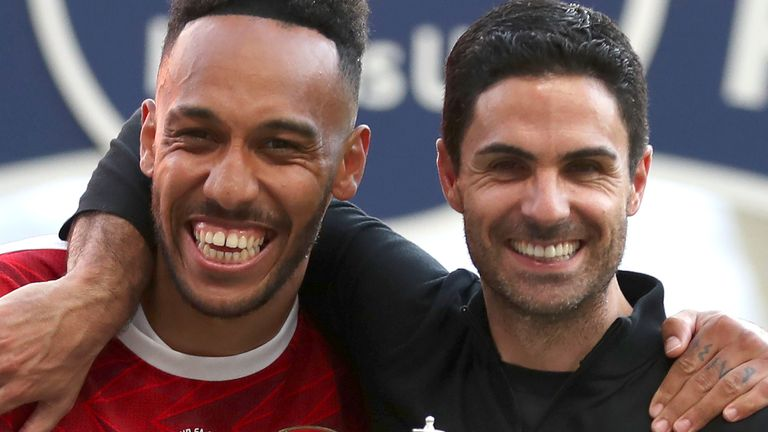 Arsenal's head coach Mikel Arteta and Arsenal's Pierre-Emerick Aubameyang pose with the trophy after the FA Cup final