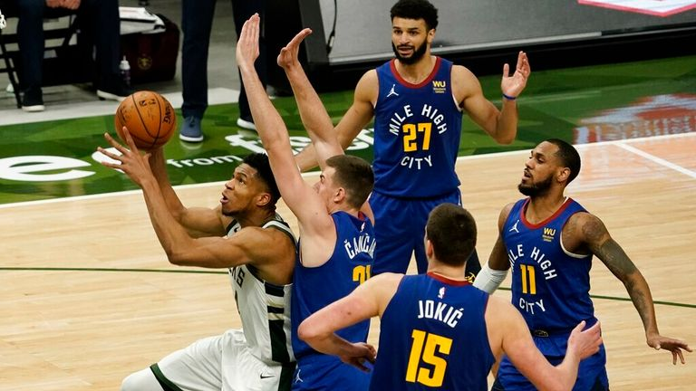 AP - Milwaukee Bucks' Giannis Antetokounmpo gets past Denver Nuggets' Vlatko Cancar