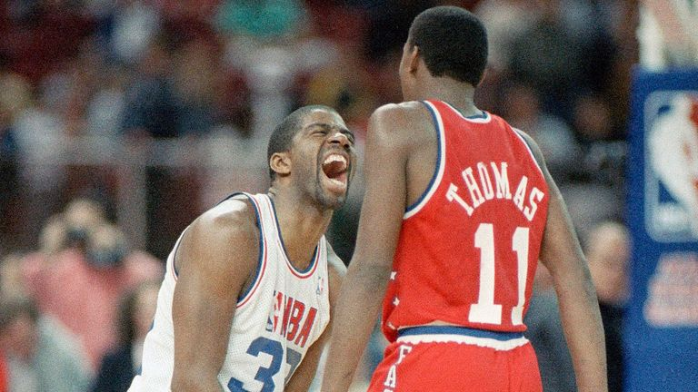 Los Angeles Lakers' Earvin Johnson, 32, left, clowns around with Detroit's Isiah Thomas (11) during Rolando Blackman's free thrown attempt which tied the NBA all Star Game forcing overtime in Seattle, Feb. 9, 1987. The West won Sunday's game 154-149.