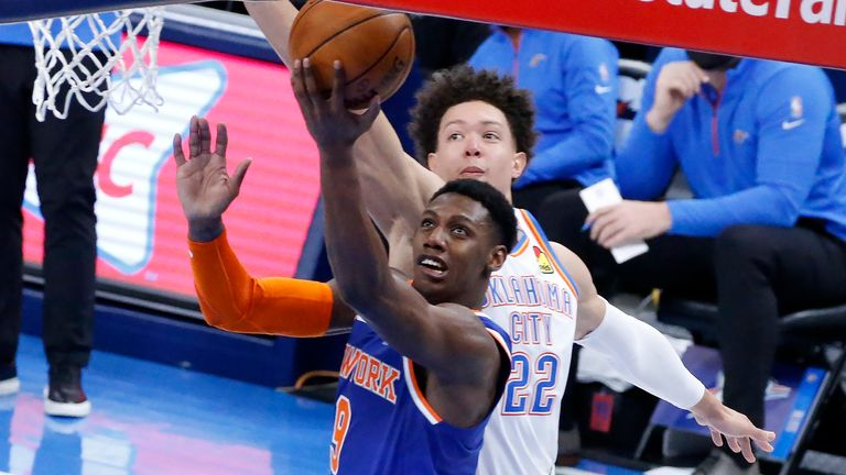 New York Knicks guard RJ Barrett (9) takes a shot against Oklahoma City Thunder center Isaiah Roby (22) during the second half of an NBA basketball game, Saturday, March 13, 2021, in Oklahoma City. (