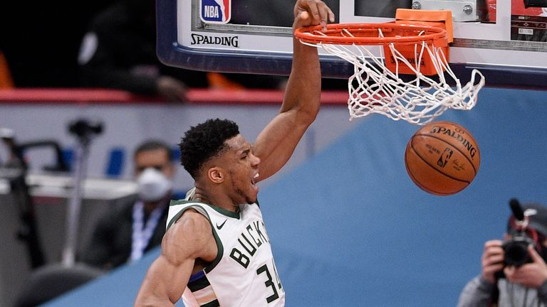 Giannis Antetokounmpo scores 33 points, 11 assists and 11 rebounds in the Milwaukee Bucks' victory over the Washington Wizards.