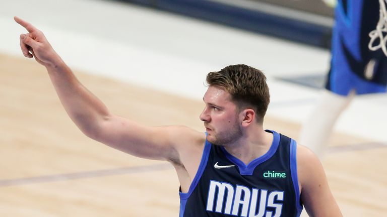 Dallas Mavericks guard Luka Doncic (77) reacts to an offensive and technical foul call against him during the first half of an NBA basketball game against the San Antonio Spurs, Wednesday, March 10, 2021, in Dallas. (AP Photo/Brandon Wade)