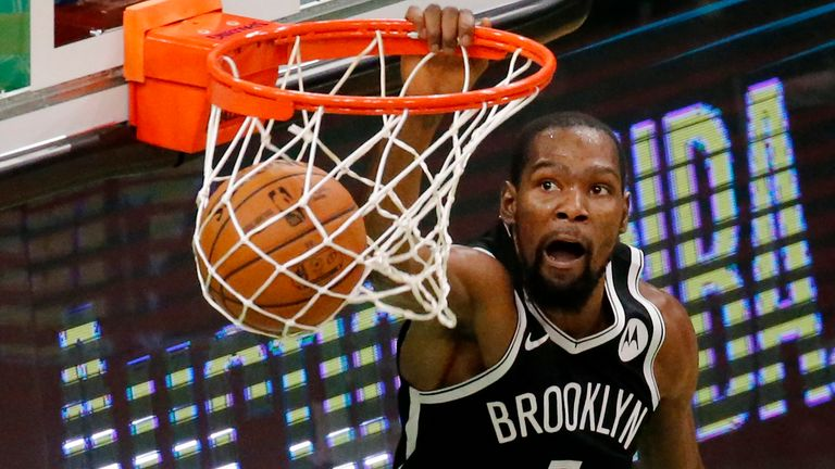 Brooklyn Nets forward Kevin Durant (7) dunks during the second half of an NBA preseason basketball game against the Boston Celtics, Friday, Dec. 18, 2020, in Boston.